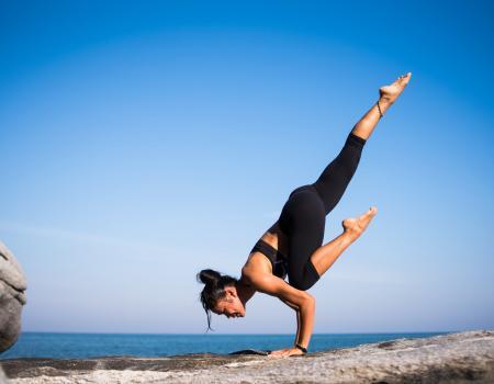 yoga on rock at lake