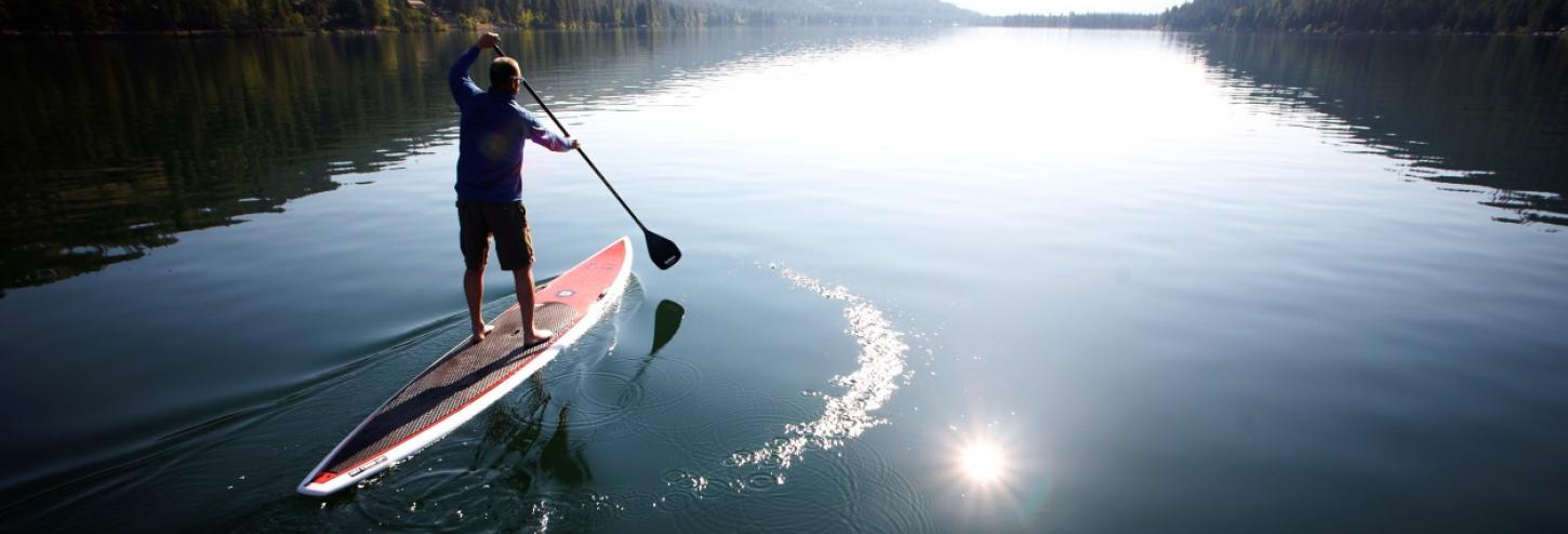 Man paddle boarding on Lake Tahoe