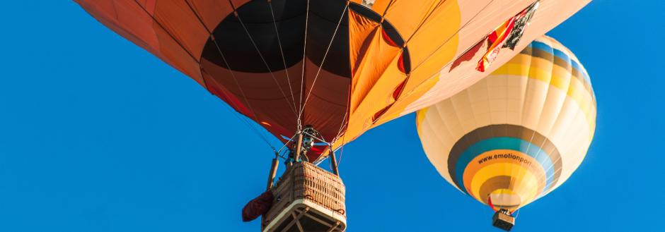 A hot air balloon cabin floating in the sky