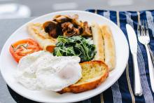 Breakfast food with eggs and toast.