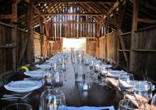 Farm to table dinner settings in a rustic barn