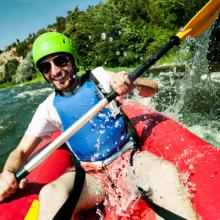 man-having-fun-river-rafting