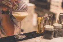 Bartender serving up a margarita