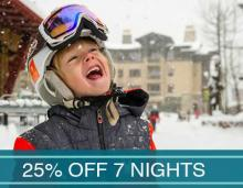 Young boy smiling with a snowboarding helmet on