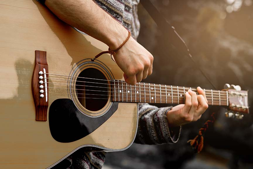 Performer playing a guitar